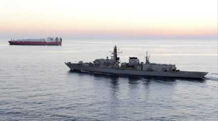 British navy vessel HMS Montrose escorts another ship during a mission
