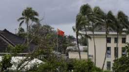Chinese flag flies outside the Chinese Embassy