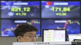 currency trader watches monitors