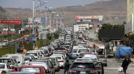 Cars queue at a petrol station during a fuel crisis in Sanaa, Yemen