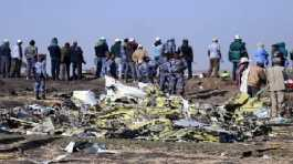 Ethiopian Federal policemen stand at the scene of the Ethiopian Airlines Flight ET 302 plane crash