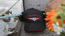 A ball cap with the name of the crab fishing boat Scandies Rose rests at the Seattle Fishermen's Memorial