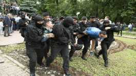 Kazakh police detain demonstrators during an anti-government protest