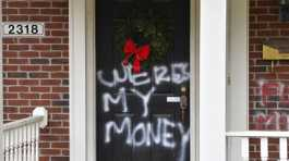 Where's my money is seen on a door of the home of Mitch McConnell